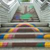 中川西中学校美術部の描いた歩道橋の階段絵を洗浄